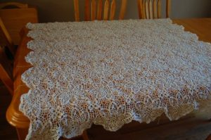 My current project--crocheted lace tablecloth. It finally drapes over widthwise, but lengthwise? I have a ways to go...